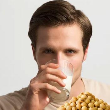 Man drinking soy milk