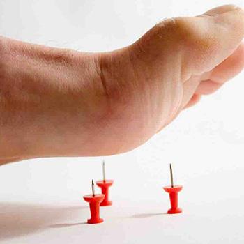 pins under foot