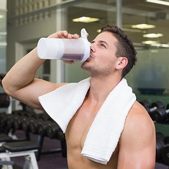 man drinking supplement