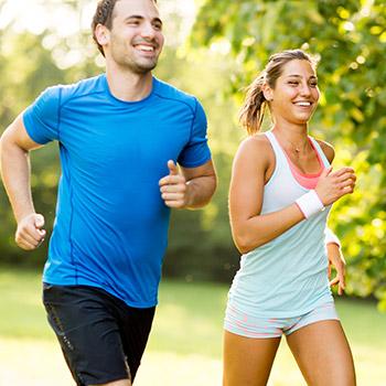 man and woman jogging