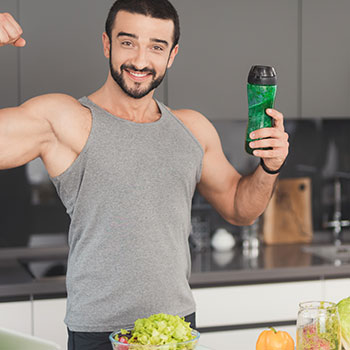 man holding a tumbler