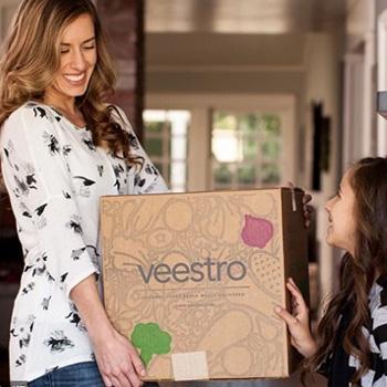 woman holding veestro box
