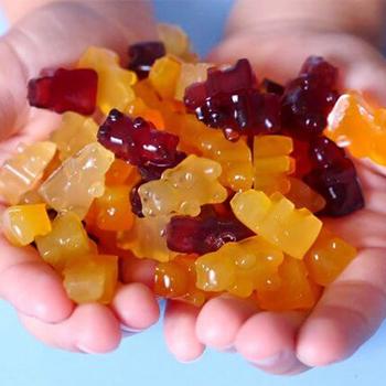 holding gummy bears in hand