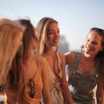 four woman talking
