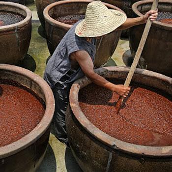 man making soy sauce