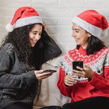 ladies wearing christmas jumpers