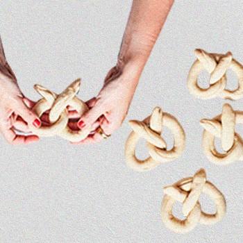 A Hand Making Pretzels